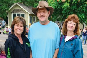From right: Mary Wooldrige, Jim Alden and Judy Bernard pose for a photo during the Berthoud Day parade.  John Gardner/ the Surveyor