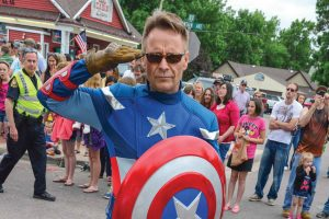 Steve Jorgenson, aka Captain America, salutes people lining Mountain Avenue during the Berthoud Day parade on Saturday, June 7 in Berthoud. Jorgenson participated in the parade as part of Calvary Berthoud's float and was popular at Town Park, taking pictures and handing out balloons for kids and others.  John Gardner/ the Surveyor