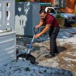 Despite it being July, George Jacobo uses a snow shovel to clear the sidewalk in front of Mi Cocina Mexican Restaurant in Berthoud Monday afternoon after a powerful hailstorm came through.  All images John Gardner / The Surveyor