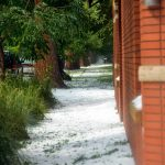 A sidewalk along 5th Avenue in Berthoud is covered with hail after the storm dumped up to two inches of hail in spots.  John Gardner / The Surveyor