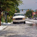 Folks take pictures and assess the situation after a powerful storm came through town Monday afternoon bringing heavy rain and hail.  John Gardner / The Surveyor