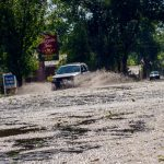 The storm that came through Monday afternoon filled Mountain Avenue in Berthoud with water and hail to the point of overfilling the gutters.  John Gardner / The Surveyor