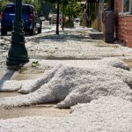 Hail piles on the sidewalk in front of Mi Cocina in Berthoud, Monday afternoon.  John Gardner / The Surveyor