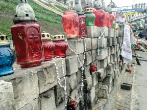Memorial candles and rosaries adorn a stone wall at Maidan Square in Kiev, Ukraine in April. All photos courtesy of Kris Stoesz