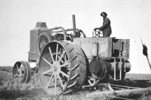 "Ben Green who worked for Sid Davis, paused in the field for a photo on a ""Rumley 6"" tractor. Davis also used a 1916 Titan tractor in his wheat farming operation. All photos courtesy of the Ludlow Collection/ Berthoud Historical Society"