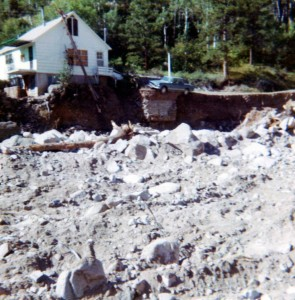 At 15, Sue Brungardt documented the destruction after the Big Thompson Canyon flood in 1976. The photo on the left shows a car precariously on the edge of a small droppoff where the floodwater washed away the riverbank.  Photo courtesy of Sue Brunghart