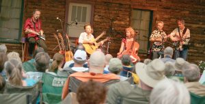 Left to right: Butch Hause, Joe Scott, Hannah Alkire, Ernie Martinez and Pete Huttlinger perform at the 11th Annual Farm Concert near Berthoud in August 2013. Surveyor file photo