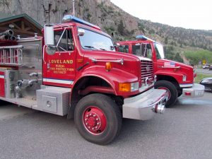 As the 38th Big Thompson flood memorial unfolded, fire trucks sat nearby and at the ready.
