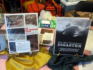 After remembering the victims of two floods in the Big Thompson, the crowd enjoyed snacks and some purchased books about the flood.