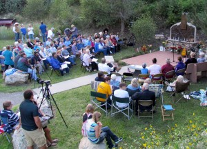 A crowd gathered early in the evening at the Drake fire station to remember both floods in the canyon.
