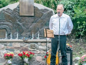 Jerry Shafer, a survivor of the 1976 flood, tells his story of riding the wave of floodwaters and losing his friend and neighbor in the Big Thompson Canyon Flood of 1976 at the 38th Annual Remembrance of the flood on Thursday, July 31 near Drake in the Big Thompson Canyon. This year's ceremony was even more significant with the floods of 2013 fresh on everyone's minds. All photos by Bob McDonnell/ The Surveyor
