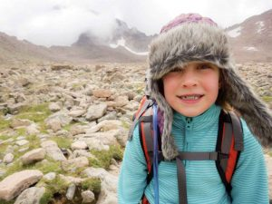 Berthoud's 9-year-old Mollie Davidson smiles for the camera in the boulder field at the base of Longs Peak on Aug. 2. Davidson attempted to hike the 14,000 Longs Peak to raise funds for Second Mile Water.