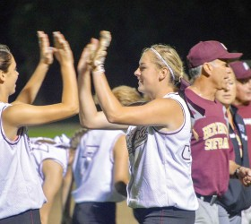 Berthoud's Sydney Kouns, left, and Taylor Armitage celebrate after the 13-3 victory over the Thompson Valley Eagles at Bein Field in Berthoud, Friday, Aug. 22. John Gardner / The Surveyor