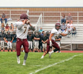 Spartans' quarterback Cody Braesch prepares to pass to wide receiver Micol Woodiel at a preseason scrimmage on Aug. 23. The Spartans begin their season at Valley High School on Friday, Aug. 29.  Karen Fate / The Surveyor