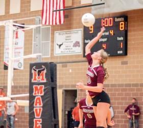 Berthoud's Hannah Atkinson drills another ball at Mead's blockers. Paula Megenhardt / The Surveyor