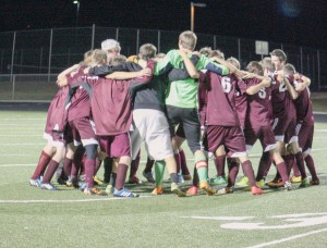 The Berthoud High School boys soccer team comes together after its final game.  Angie Purdy / The Surveyor