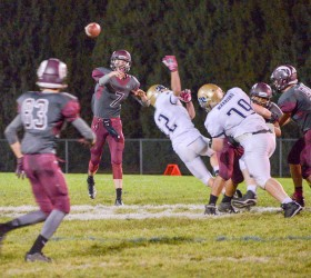 Berthoud quarterback, Cody Braesh, 7, passes for another completion to wide receiver Jackson Hall during the game against Frederick on Oct. 17 at Max Marr Field. Braesh and Hall connected for both Berthoud touchdowns in the game.  John Gardner / The Surveyor