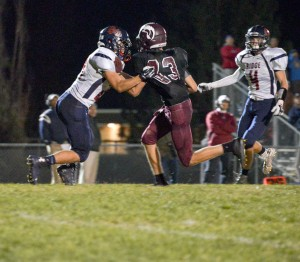 Berthoud wide receiver Jackson Hall, 83, breaks a tackle against a Northridge defender on Oct. 24 at Max Marr Field in Berthoud. This was Hall's second touchdown in the game, and two-TD game for the second week in a row, but that wasn't enough to overcome Northridge.  John Gardner / The Surveyor
