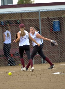 Berthoud softball pitching duo, Taylor Armitage and Larissa Royer celebrate during a recent game at Bein Field at Berthoud High School. The Berthoud Spartans will travel to Colorado Springs to play in the Regional Tournament which begins Oct. 11.  Surveyor file photo