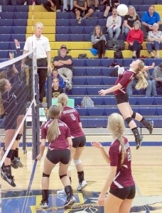 Spartans teammates cover the court as right side hitter Julie Ward goes up for the kill against Frederick on Oct. 9. Paula Megenhardt / The Surveyor