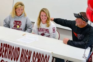 Berthoud's Jessi Boruff and her parents, Sandi and Doug Boruff, react after Jessi signed her letter of intent to play softball at Colorado Mesa University in Grand Junction, on Nov. 12 at BHS. John Gardner / The Surveyor