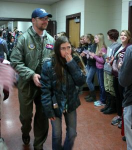 Veteran Aaron Rath walks down the hallway following the flag retirement ceremony. BHS students lined the hallway on both sides from the Commons to the auditorium, amidst waving flags and clapping, the veterans then walked down the hallway to watch the program in the auditorium. Jan Dowker / The Surveyor