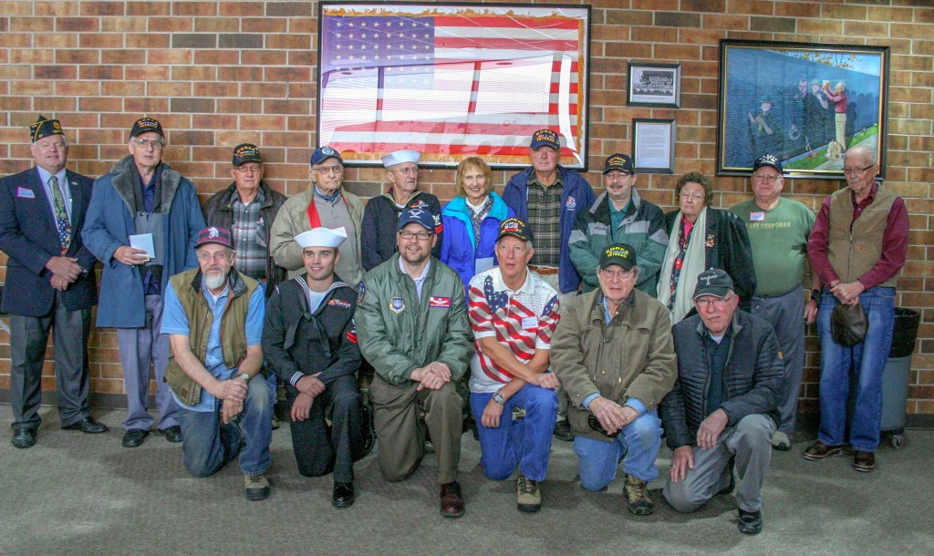 All the veterans in attendance posed for a photo outside of the Berthoud High School auditorium after the recognition ceremony on Nov. 11.  Jan Dowker / The Surveyor