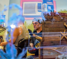Surfbilly Tattoo owner and tattoo artist, J.D. Markwardt, tattoos Berthoud resident Jeff Wicks on an October evening, just a few weeks after opening the tattoo parlor located at 435 Third St. in Berthoud.  John Gardner / The Surveyor
