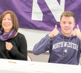 Berthoud High School student and swimmer Jack Thorne and his mother, Jodi Juskie, expresses their excitement after Jack committed to swim at Northwestern University in Illinois, on Nov. 13 at BHS. Thorne swims with the Thompson Valley High School and the Loveland Swim Clubs and is a two-time defending 4A state champion in the 100-yard backstroke and defending state champion in the 100 butterfly. Photo courtesy of Kim Skoric