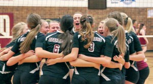 The Berthoud High School volleyball team celebrates its victory at regionals on Nov. 1 at Berthoud High School. The team is on its way to the state championships, Nov. 7-8 at the Denver Coliseum, for the first time since 2008.  Paula Megenhardt / The Surveyor