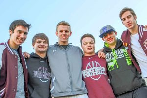 From left to right: Berthoud's Brendon Stanley, Chad Ellis, Cody Braesch, Jimmy Fate, Stephen Lockard and Jackson Hall have played football together since fourth grade. Now, all juniors at BHS, they prepare to play in their first playoff game as Spartans.  Photo by Dan Megenhardt
