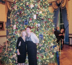 Carin Barrett, right, poses in front of the White House's offi cal Christmas tree, along with fellow Berthoud High School teacher Ann Gonzales, who accompanied Barrett to the volunteer reception for those who decorated the house for the holidays. Barrett was one of 76 volunteers selected to help decorate the White House for the Christmas holiday this year. Photo courtesy of Carin Barrett / The Surveyor