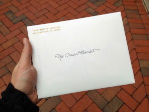 """Barrett holds the official invitation to the volunteers' reception at the White House after a few days of decorating. """"I was so excited I didn't really want to open it and damage the envelope,"""" Barrett said."""