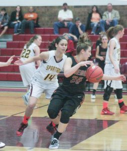 Berthoud's Sydney Kouns defends Mead's Haylee McCullough on Jan. 27 at Berthoud High School. The Lady Spartans won the contest 58-45. Karen Fate / The Surveyor