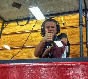 Berthoud's Kolten Strait gives a thumbs-up while broadcasting a wrestling match at Berthoud High School for Overtime Sports Net. Photo courtesy of Jill Strait / The Surveyor