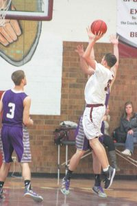 Berthoud's Noah Purdy takes a shot during the game against Holy Family. Angie Purdy / The Surveyor
