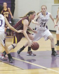 Berthoud's Taylor Armitage pushes for the basket against Holy Family at Berthoud High School on Jan. 23.  Karen Fate / The Surveyor