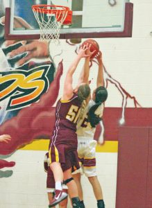 Berthoud's Taylor Armitage grabs a rebound during the contest versus Windsor on Feb. 10. Karen Fate / The Surveyor