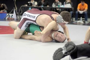 Berthoud's Chad Ellis wrestles Delta's Kory Mills in the 3A 170-pound championship match on Feb. 21 at Pepsi Center in Denver. Ellis won the match and his first state title.