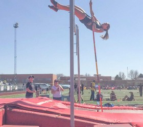 Berthoud's Kelly Chamberlain soars almost a foot above her personal best in teh pole vault, clearing 10 feet at the Runner's Roost Invitational in Fort Collins on March 21. Photo courtesy of Lisa Spitz / The Surveyor