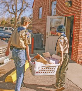 Jace Courtright and Richard Schiraldi delivered food to the House of Neighborly Services offi ce in Berthoud. Kayla Dome / The Surveyor