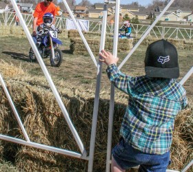 Treyson Barr watches his older brother, 3-year-old Bryson take a spin on a motorcycle at American Supercamp's learn to ride clinic during the Alex Sabados Day of Kindness. Jan Dowker / The Surveyor