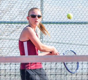 Berthoud's Bridget Hyde prepares to return a shot against Skyline's Andrea Rauschmayer during a match at Berthoud High School on March 30. Hyde won the contest in straight sets, 6-2, 6-1 and helped her team win its third team victory of the season. The Spartans are at 3-3 on the season. John Gardner / The Surveyor
