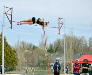 Josie Spitz clears the bar at 10-feet, 9-inches in the jump-off against Poudre's Mia Moret.  John Gardner/ The Surveyor