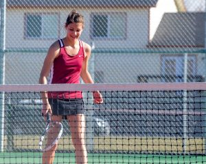 No. 1 singles Emily Marty smiles after winning a point during her match against Skyline's NoNo Ncube on March 30 at Berthoud High School.  John Gardner / The Surveyor