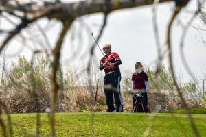 Berthoud's Molli Boruff watches her tee shot on the par-3 10th hole at The Mad Russian Golf Course in Milliken on April 20. Boruff won the contest with a low round, 85.  John Gardner / The Surveyor