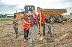 The Tatum family, from left, includes Kyle, 9, Trinity, 12, Stephanie and Mike, and Collin, 6, each pitches in and helps break ground at the site of their new Habitat for Humanity home in Berthoud earlier this month. The Tatums are the second family this year to receive a home through Habitat for Humanity program. Becky Justice-Hemmann / The Surveyor