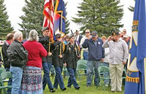 Veterans and residents salute the Thompson Valley High School Color Guard as they present the American and Colorado flags during the Memorial Day ceremony at Greenlawn Cemetery in Berthoud on Monday, May 25. More than 100 people attended the annual event hosted by the American Legion Justin Bauer Memorial Post 67 and the American Legion Auxiliary. Photo by Becky Justice-Hemmann / The Surveyor