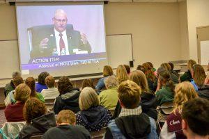 People watch school board president Bob Kerrigan in the overflow room of the Board of Education meeting Wednesday.  John Gardner / The Surveyor