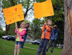 """Ayden Wolf, 9, right, and his sister, Sydney Wolf, 7, both students at Ivy Stockwell Elementary, hold signs in support of Thompson School District Teachers Friday Afternoon at Fickel Park in Berthoud.  A group of local parents and grandparents gathered at Fickel Park on Friday afternoon to gather signatures on a letter of support for Thompson School District teachers. """"We love our teachers and so we're just supporting them,"""" said Ayden and Sydney's mother, Jamie Wolf. """"We want the best for them like they want the best for our kids."""" John Gardner / The Surveyor"""